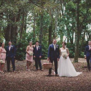 Bridal party in blush pink with navy blue suits