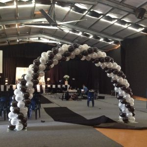 black, white and silver balloon arch