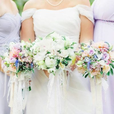 Soft pastel bouquets with ribbons and pearls